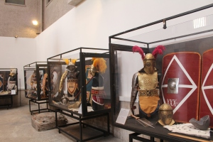 "Some replica sets of Gladiatorial armour and weaponry.  There were distinct ""styles"" of gladiator."