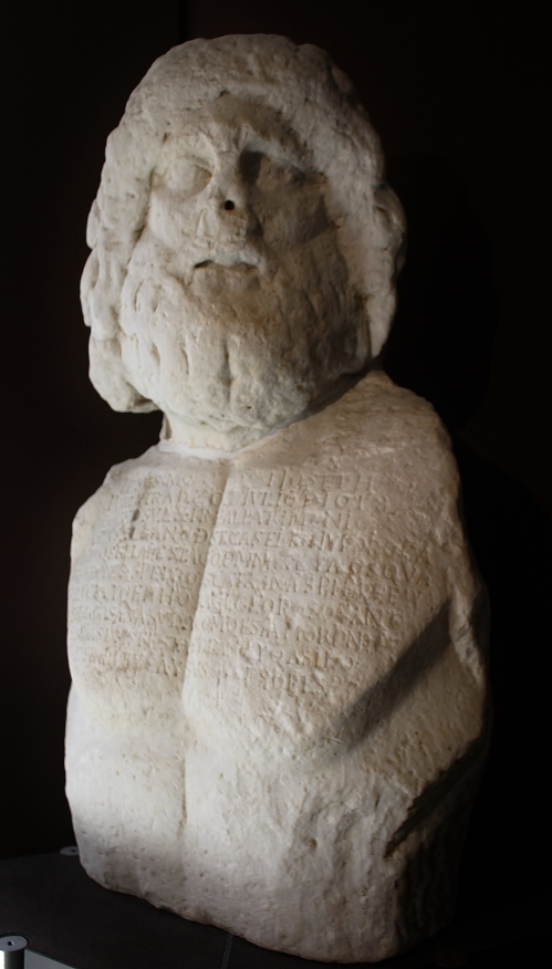 This large statue of Asklepios is a late 1stC AD Roman copy of a Greek original and was found in Ortygia in 1530 where it was displayed in the Castel Maniace. The inscription across the chest is not original, it describes the dedication of Castel Maniace to St Jago (James) and the castle towers to the patron saints of Ortygia, Pete, Catherine, Philip and Lucia.