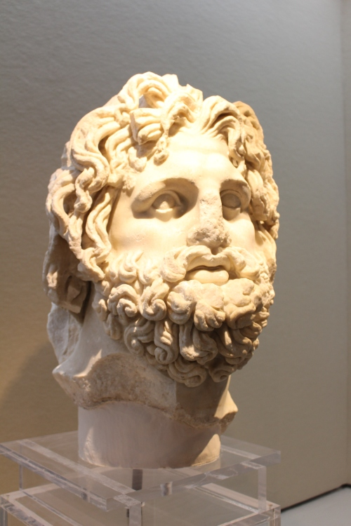 Massive head of Asklepios in marble. Found in the Neapolis amphitheatre. Augustan copy of an Hellenistic original by Phyromachos
