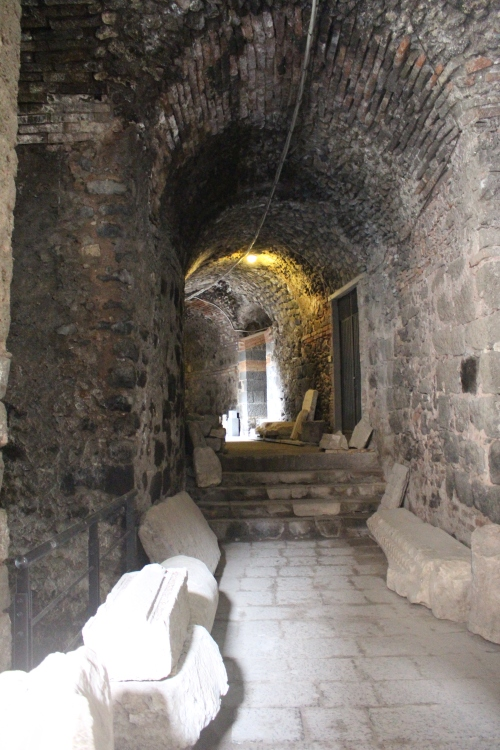 The aditus (in Greek) or vomitorium (in Latin,) - the entrance tunnels for the audience to reach the seating in the cavea