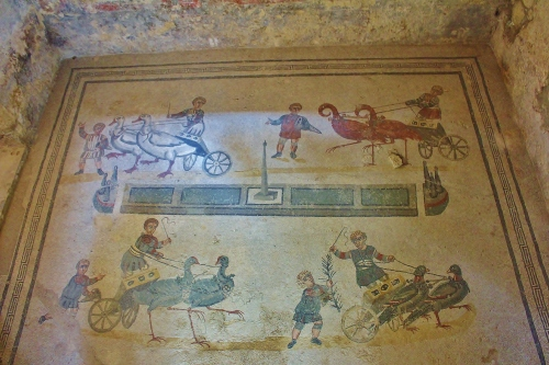 The Vestibule of the Little Circus - an amusing image of chariot racing, only with birds instead of horses. The four factions are represented by child charioteers