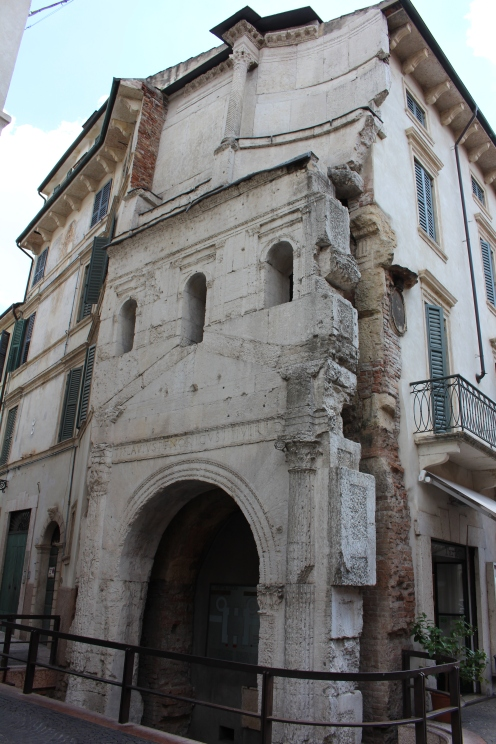 The marble of the arch was added to the brick, Republican-era structure in the 1stC AD